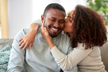 happy african american couple kissing at home Stockfoto - 132026916