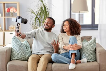 couple of video bloggers with camera at home Stockfoto - 132026977