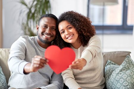 happy african american couple with heart at home Stockfoto