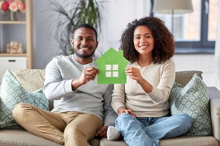happy african american couple on sofa at home Stockfoto - 132027033