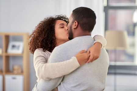 happy african american couple kissing at home Stockfoto - 132027097