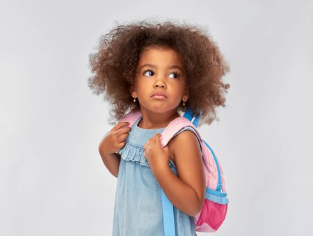 sad little african american girl with backpack Stockfoto