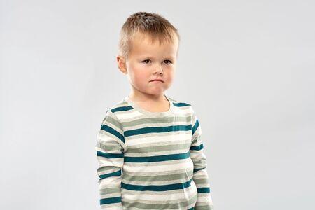 portrait of sad little boy in striped shirt Stockfoto