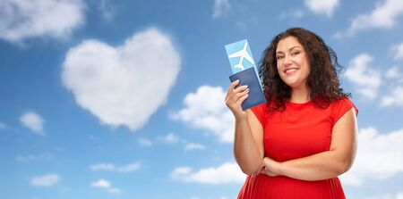 happy woman with passport and air ticket