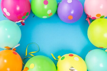 party balloons and confetti on blue background