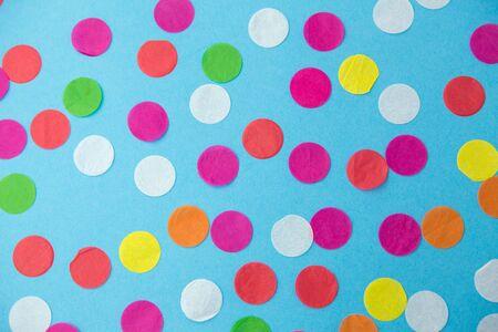 colorful confetti decoration on blue background