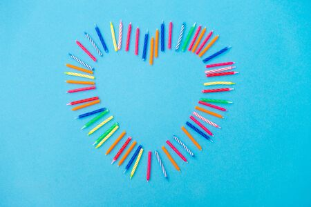 valentines day, birthday and decoration concept - frame of cake candles in shape of heart Stock fotó