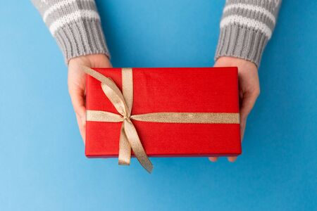 Hands holding red Christmas gift box Stock Photo