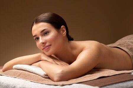 young woman lying at spa salon or massage parlor Фото со стока - 133683805
