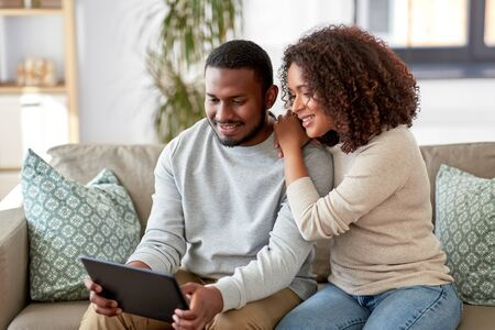 african american couple with tablet pc at home Banco de Imagens