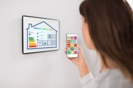 woman using tablet pc and smartphone at smart home
