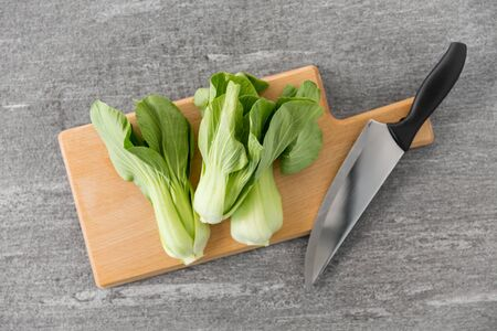 bok choy cabbage and knife on cutting board