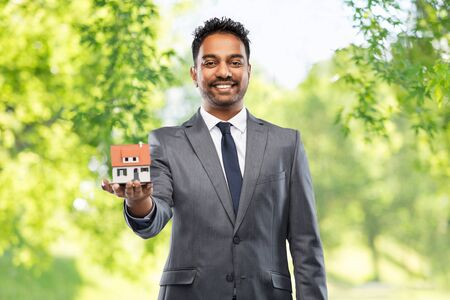 indian man realtor with house model