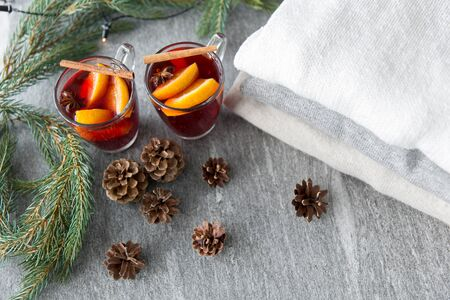 mulled wine with orange and spices, cones and fir Stock fotó