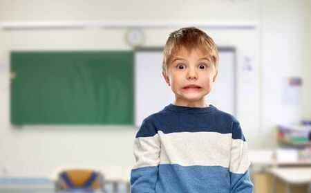 shocked little boy at school