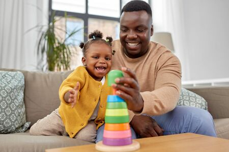 african family playing with baby daughter at home Standard-Bild