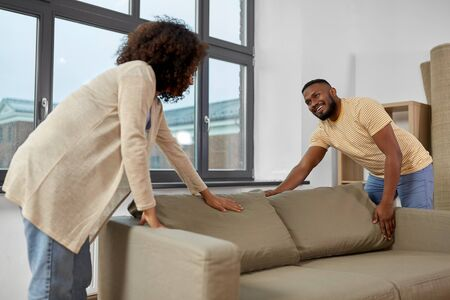 happy couple moving to new home Stock Photo