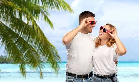 happy couple in white t-shirts and sunglasses