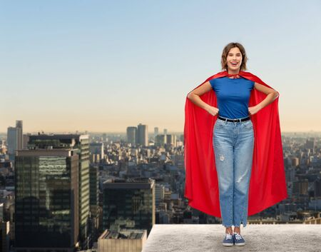 happy woman in red superhero cape over tokyo city