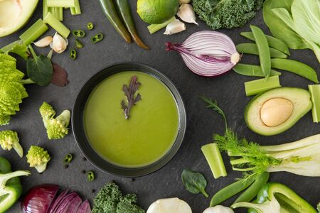 green vegetables and cream soup in ceramic bowl
