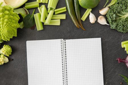 green vegetables and diary with empty pages Stock fotó