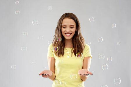 young woman or teenage gir with soap bubbles Stock Photo