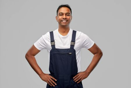 happy smiling indian worker or builder