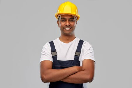 happy indian worker or builder with crossed arms Stock fotó