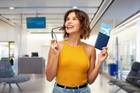 happy young woman with air ticket at airport Stock fotó