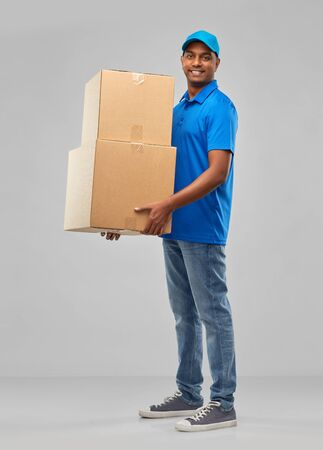 happy indian delivery man with parcel boxes