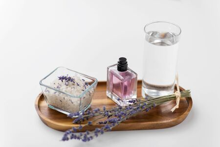 sea salt, perfume and lavender on wooden tray Stock Photo