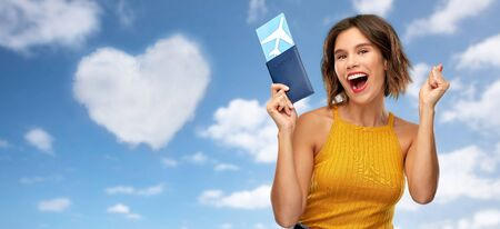 happy young woman with air ticket and passport Archivio Fotografico