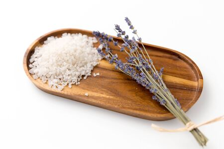 sea salt heap and lavender on wooden tray