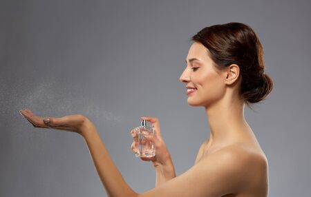 happy woman with perfume