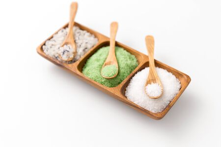 sea salt and spoons on wooden tray 写真素材