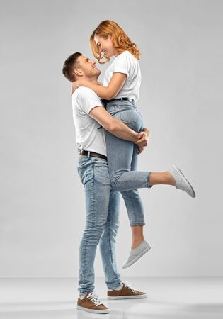 happy couple in white t-shirts Stock Photo - 137062400