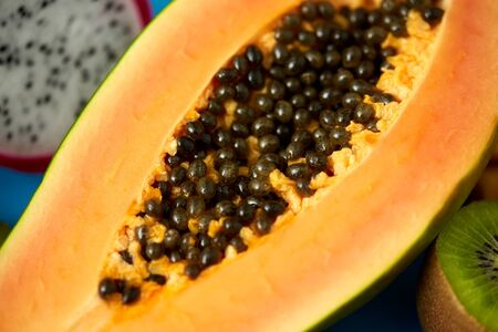 fruits, diet and food concept - close up of ripe papaya with seeds