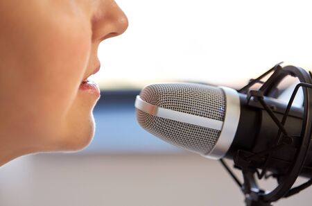 close up of woman talking to microphone