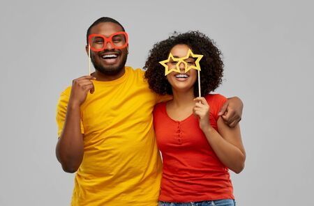 happy african american couple with party props