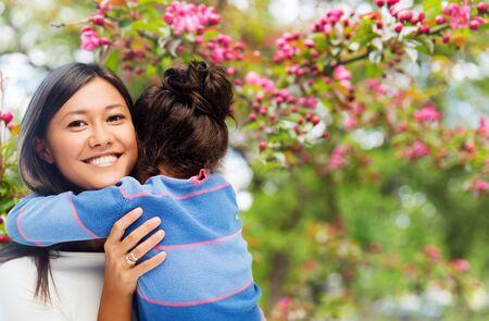 happy mother and daughter hugging over garden Stock fotó