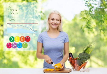 smiling young woman cooking vegetables