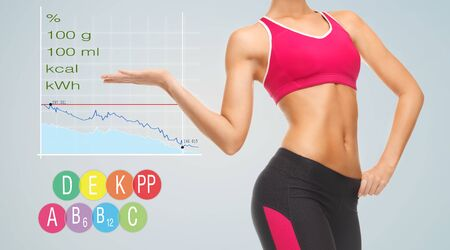 eating, diet and people concept - close up of slim fit woman showing chart with calories, vitamins and nutritional value
