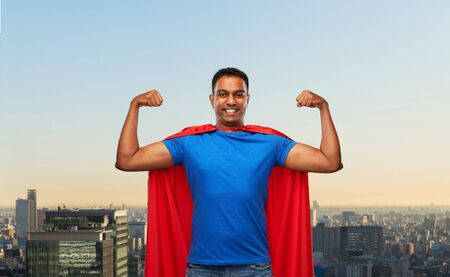 indian man in superhero cape showing his power