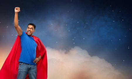 indian man in superhero cape over night sky 版權商用圖片