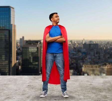 happy indian man in red superhero cape in tokyo