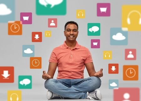 happy man in yoga lotus pose over app icons