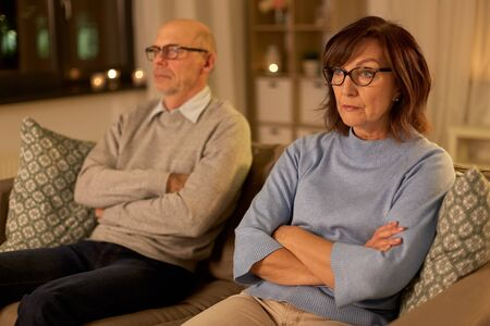 unhappy senior couple sitting on sofa at home Stock fotó