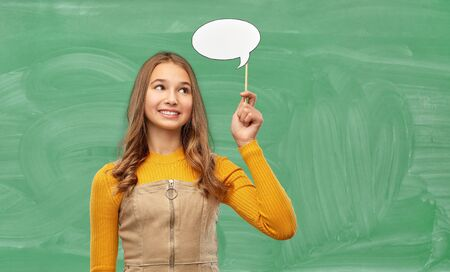 student girl with speech bubble over chalk board