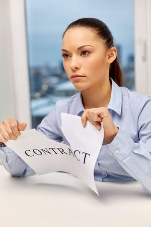 businesswoman terminating contract at office