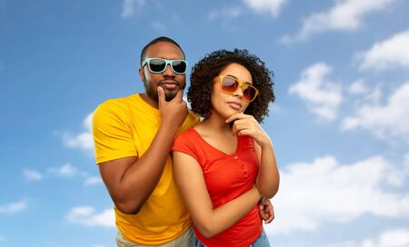 african couple in sunglasses thinking